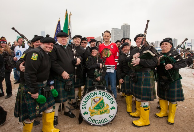 Vince Vaughn, center in Blackhawks jersey, takes part in the Chicago Polar Plunge at North Avenue Beach on Sunday, March 1, 2015 in Chicago. (Photo by Barry Brecheisen/Invision/AP)